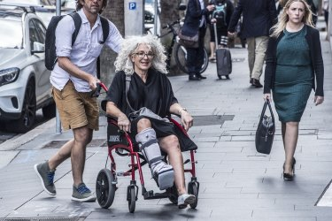 Eddie Obied's barrister April Francis arrives at the Supreme Court in a wheelchair.