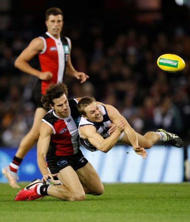 Geelong's Tom Atkins is tackled by St Kilda's Max King.