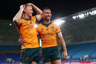 Quade Cooper celebrates with Reece Hodge after kicking the winning penalty.