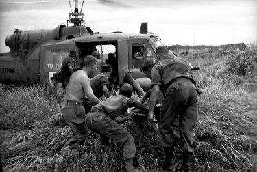 A wounded 1st Battalion soldier is lifted into Medi-vac helicopter after the accident on June 26, 1965.
