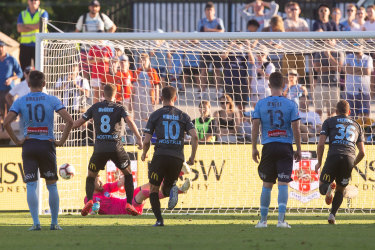 Impregnable: Andrew Redmayne saves a penalty from Riley McGree at Jubilee Oval.