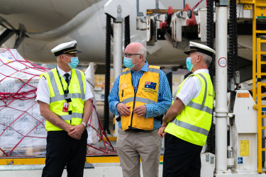 Qantas Captain Phillip Emanuel (L) with Australia's High Commissioner to the UK George Brandis and Captain Brett Meyer (R) at Heathrow airport on Saturday 4 September, 2021.