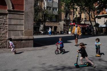 Children play at Plaça de la Vila de Gracia on April 26, 2020 in Barcelona, Spain.