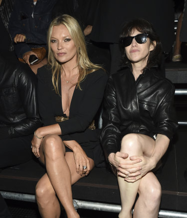 Model Kate Moss, left, and Charlotte Gainsbourg attend a fashion show.
