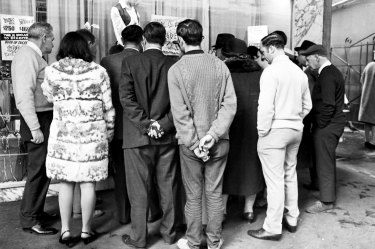 People gather outside Dixons department store in Sydney to watch a live telecast of the moon landing.