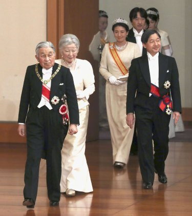 Japanese Emperor Akihito, left, and Empress Michiko, second from left, Crown Prince Naruhito, right, and Crown Princess Masako, second from right, arrive for an imperial ceremony on  New Year's Day at the Imperial Palace in Tokyo.
