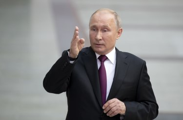 Russian President Vladimir Putin responds to a journalist's question.