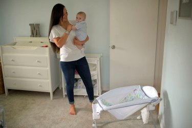 Miana Marie holds her four-month son, Mason, in his room in Alexandria, Virginia. She had used the Fisher-Price Rock 'n Play sleeper for the child until the recall.