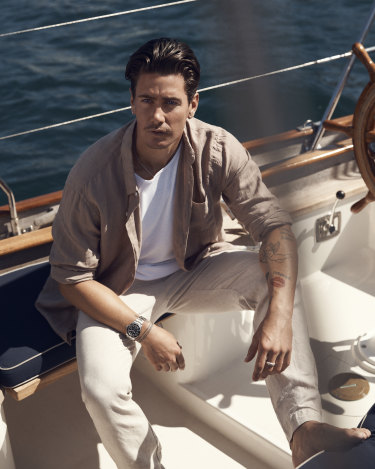 "He wears French Connection linen shirt, $100;  Bassike ""Heritage"" tank top, $90, and linen trousers, $360; and Rolex ""Submariner  Date 41"" watch, $12,900."