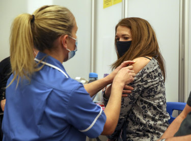 A woman receives the Moderna COVID-19 vaccine in Reading, England.