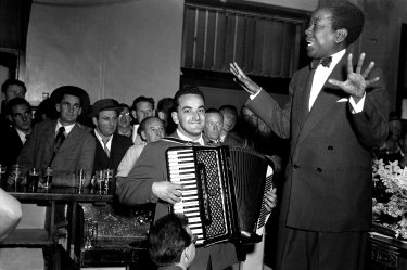 "Vocalist Nellie Small and accordionist Gus Merzi perform at the Hotel Castlereagh on August 20, 1954.  Of West Indian heritage but Sydney-born, Small was described in the papers of the time as a ""male impersonator""."