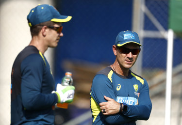 Tension: Justin Langer and Tim Paine.