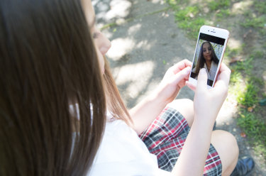 The NSW government has launched a review into the risks and benefits associated with phones in the state's schools.
