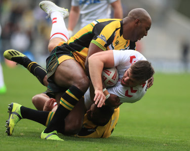 Jamaica's Michael Lawrence tackles England Knights player Joe Greenwood during last year's clash at Headingley.