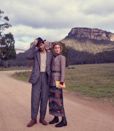 "Johanna wears Zara blazer, $139. Theron ""Vera"" sweater, $380. Maje ""Rezia"" dress, $610. Iro ""Wade"" belt, $339. Emmett wears Giorgio Armani jacket, $3400, and trousers, $1650. Venroy sweater, $120. Stylist's own hat."