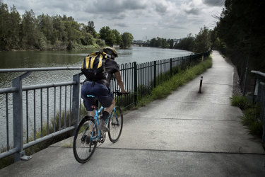 A rider on the Alexandra Canal Cycleway, which is set to be closed.