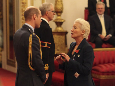 Emma Thompson is made a Dame Commander of the British Empire by Prince William.