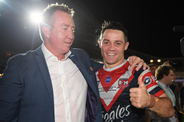 Trent Robinson and Cooper Cronk of the Sydney Roosters celebrate grand final success again.