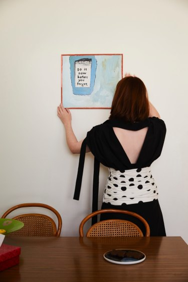 A painting by one of Minna's friends from art school, Annabelle Kingston, graces the kitchen wall.