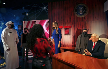 Visitors view the wax versions of Donald Trump and his wife Melania at the opening of the Madame Tussauds museum, in Dubai.