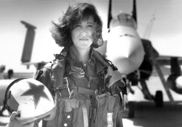 Top gun: Tammie Jo Shults, one of the first women to fly navy tactical aircraft,  in front of an F/A-18A with Tactical Electronics Warfare Squadron (VAQ) 34 in 1992. She was the pilot of the Southwest plane that made an emergency landing after an engine explosion.