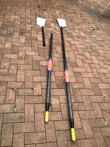 The oars (pictured) washed up on the banks of the Brisbane River on Sunday.