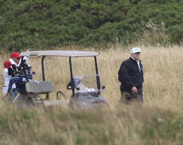 President Donald Trump plays golf at Turnberry golf club in Scotland.