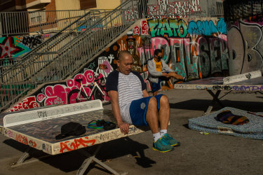 A man uses an outdoor bench in Barcelona, Spain, to exercise.