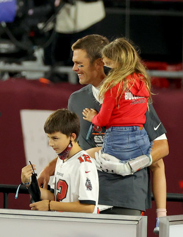 Tom Brady #12 of the Tampa Bay Buccaneers celebrates with his family after winning Super Bowl LV at Raymond James Stadium.