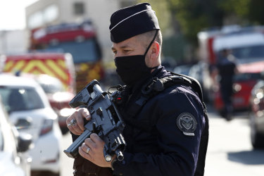 Police officer guards the police station in Rambouillet where the attack took place.