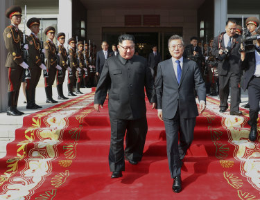 """After Saturday's surprise inter-Korean talks, South Korean President Moon Jae-in said Kim was still committed to the """"complete denuclearisation"""" of the Korean Peninsula."""