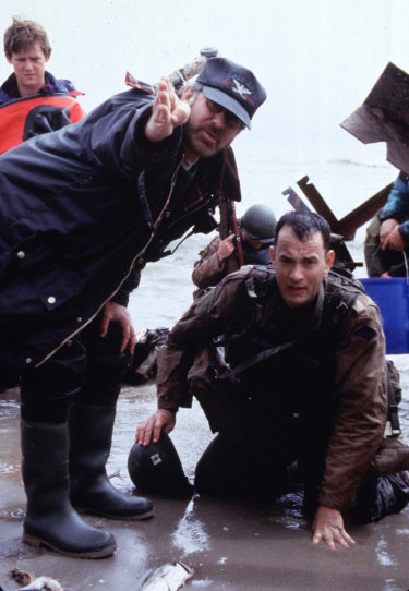 Steven Spielberg directs Tom Hanks as he portrays Captain John Miller in Saving Private Ryan.