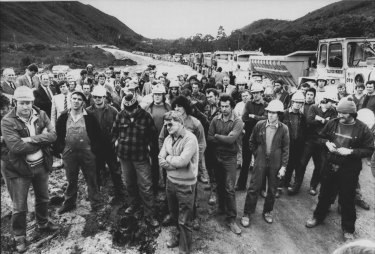 Dam workers listen to the Tasmanian Premier, Mr. Gray, near the dam site on July 4, 1983.