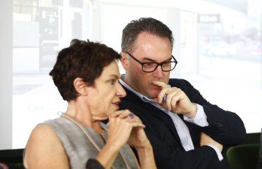 John McGrath listens to chairman Cass O\'Connor at the McGrath AGM.