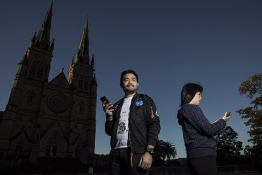 Pokemon GO player Nelson Cheng and researcher Kathleen Yin at St Mary's Cathederal in Sydney's CBD.