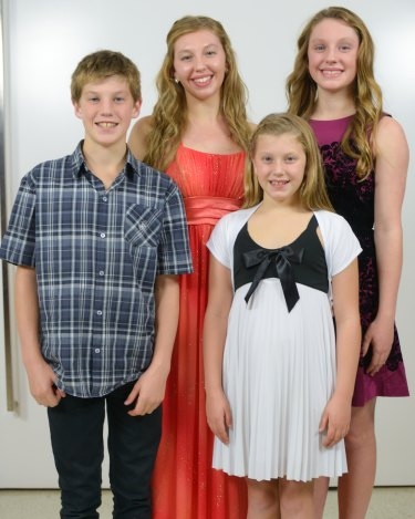 The Smith swimming family: Brendon Smith at age 13 with his older sisters Nerice and Mikayla and younger sister Reidel.