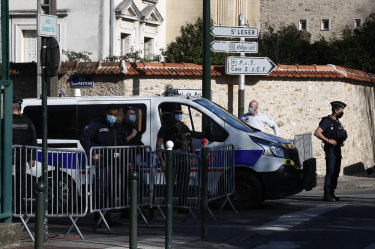 Police stand guard as President Emmanuel Macron said France had again been the victim of a terror attack.