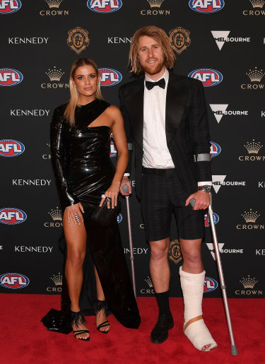 Dyson Heppell of the Bombers and Kate Turner arrive.
