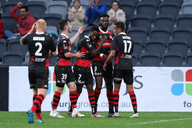 Bernie Ibini celebrates with teammates after his first half goal.