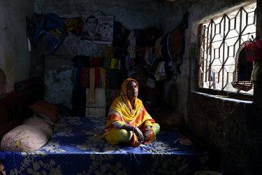 Garment worker Chameli, 30, in Dhaka, Bangladesh.