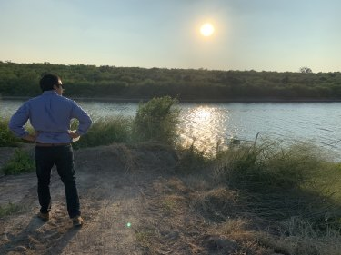 Laredo resident and lawyer Carlos Flores overlooking the Rio Grande river.