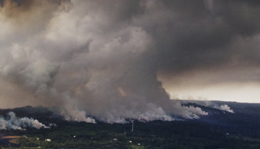 A plume of volcanic steam rises from the alignment of fissures in Hawaii's Kilauea East Rift zone.