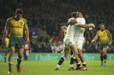England's Owen Farrell celebrates with Manu Tuilagi.