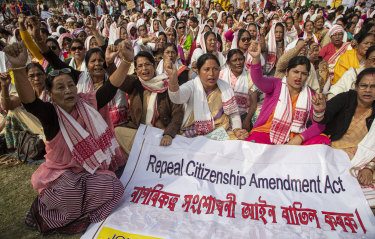 Indian women shout slogans during a protest on Saturday.