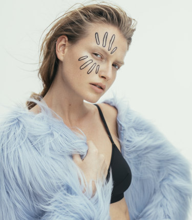 "Unreal Fur ""Dream"" jacket, $309, from The Iconic. Eres ""Lydia"" bra, $285, from Sylvia Rhodes."