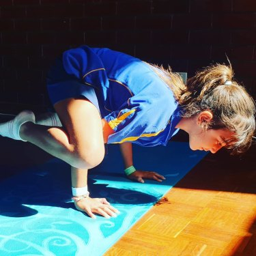 Perth primary school student taking part in PhysZen yoga.