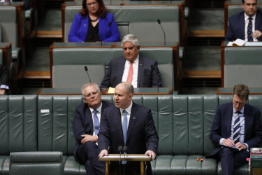 Treasurer Josh Frydenberg hands down the federal budget in early October, showing the largest deficit on record. States and territories have followed him into debt and deficit.