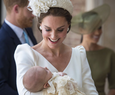 Kate, Duchess of Cambridge carries Prince Louis as they arrive for his christening service at the Chapel Royal in St James' Palace.