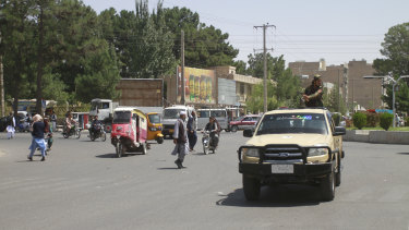 Members of the Taliban drive through the city of Herat, Afghanistan, west of Kabul, on Saturday.