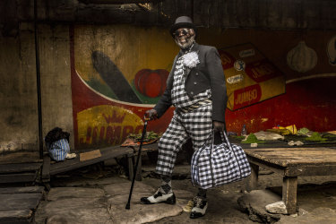 Yamea, 58, who has been a sapeur for half a century, brings colour and joie de vivre to his community. He has nine children and works as a brick-layer. His favourite item of clothing is his hat.